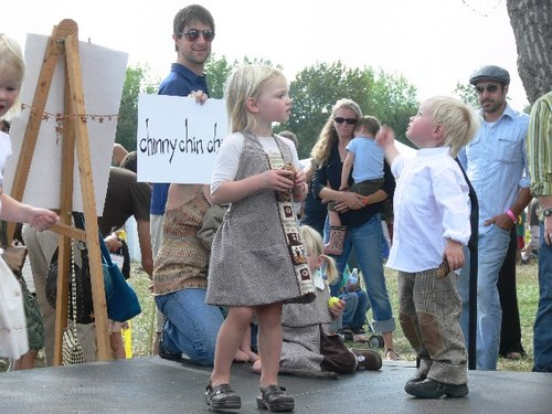 avery and arlen working the stage while uncle brian holds our sign